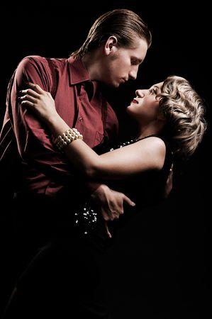 couple dancing: hermosa joven en estilo retro es el baile