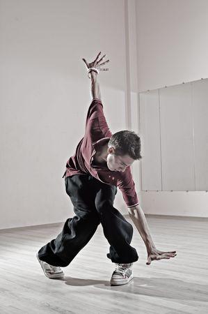 hip-hop boy posing in dance studio