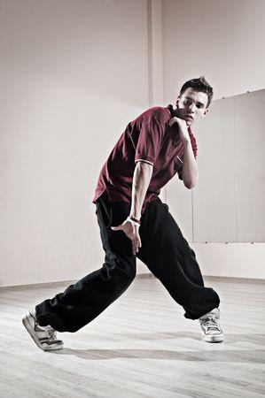 cool hip-hop boy is dancing photo