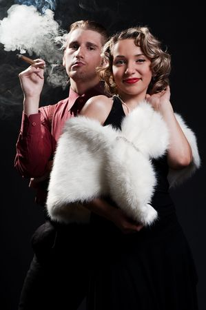 chic woman: retro portrait of chic woman and man with cigar