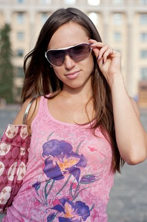 portrait of pretty young woman in sunglasses photo