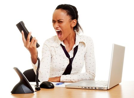 woman screaming: portrait of angry woman screaming at the phole Stock Photo