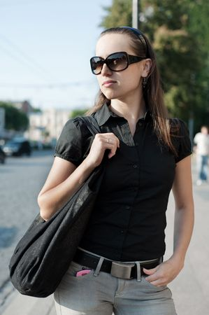 attractive woman in sunglasses against urban background Stock Photo - 5530695