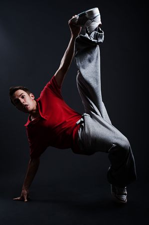emotional b-boy dancing against dark background photo