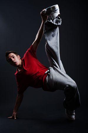 Rowdy: emotional b-boy dancing against dark background