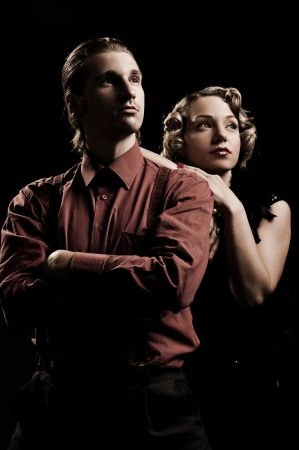 sexual relations: beautiful couple looking up against black background