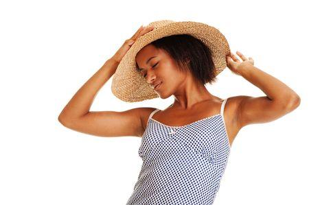 portrait of beautiful woman in straw hat photo