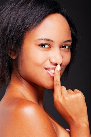 portrait of lively beautiful woman with her finger over mouth Stock Photo - 5530752