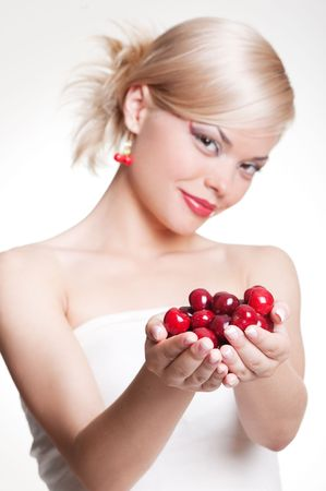 portrait of blonde with red berries photo