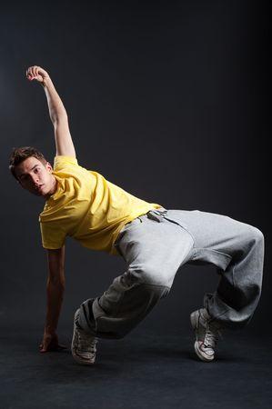 Rowdy: breakdancer in freeze against dark background Stock Photo