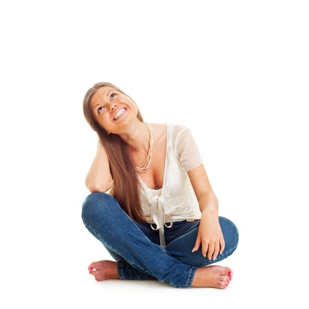 cheerful woman sitting on the floor and looking up. isolated on white Stock Photo - 5530704