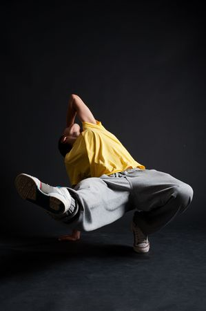 cool breakdancer in motion against dark background photo