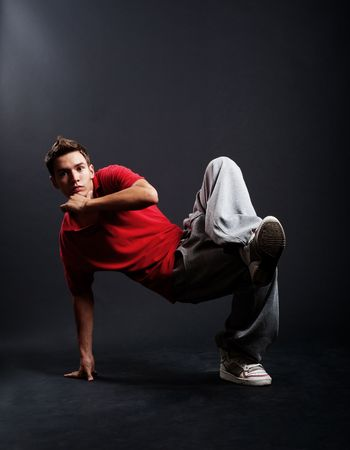 cool breakdancer dancing against dark background Stock Photo - 5530439