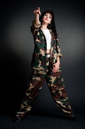 cool dancer in military uniform against dark background photo