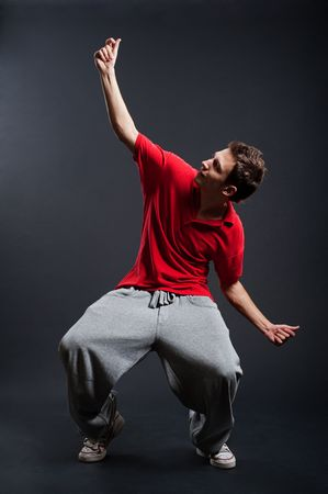 street dancer against dark background photo