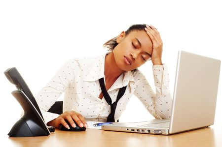 fatigued: fatigued businesswoman with headache at the workplace Stock Photo