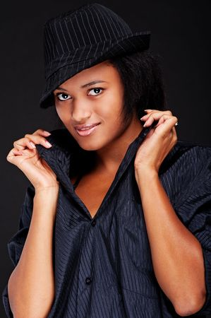 portrait of pretty smiley woman in black shirt and hat Stock Photo - 5501311