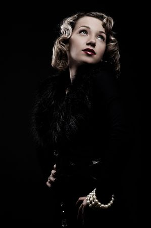 retro portrait of attractive blonde against black background photo