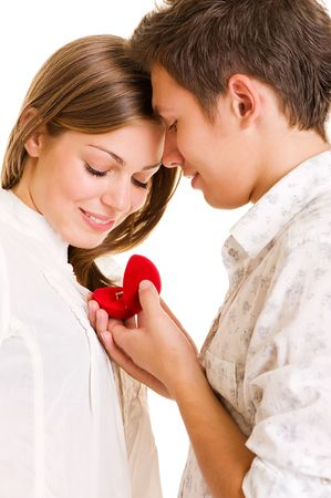 boyfriend and girlfriend: romantic moment. young man giving his beloved ring Stock Photo