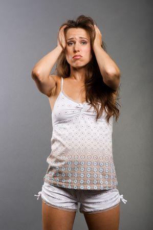 portrait of sad woman with headache in pajamas Stock Photo - 5661857