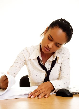 serious young businesswoman readinr report photo