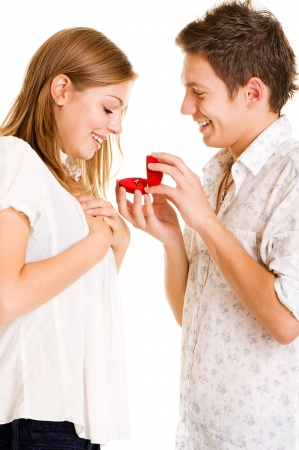 young man giving his girlfriend ring. isolated on white Stock Photo - 5661859