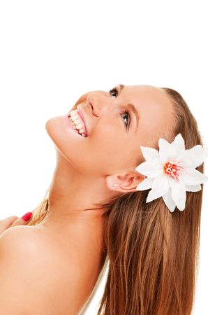 portrait of beautiful cheery woman with flower in her hair photo