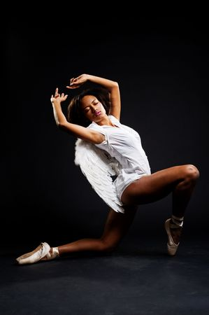 graceful ballerina dancing against dark background Stock Photo - 5661719