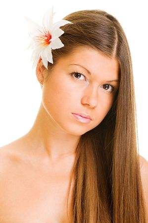 portrait of graceful young woman with white flower photo