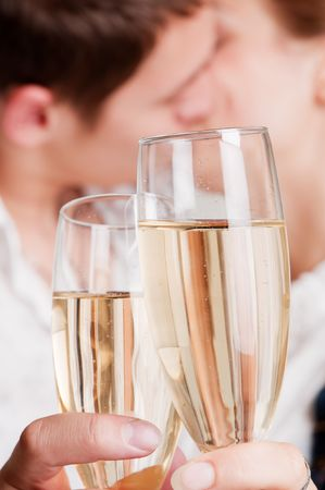 two glasses of champagne against lovers Stock Photo - 5675214