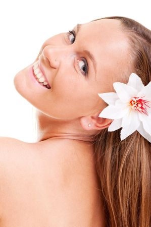 pleasant young woman with white flower in her hair Stock Photo - 5675284