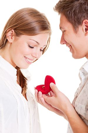 giving gift: portrait of smiley couple with ring