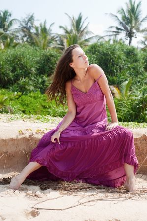 sexy woman in dress sitting on sand Stock Photo - 5847391