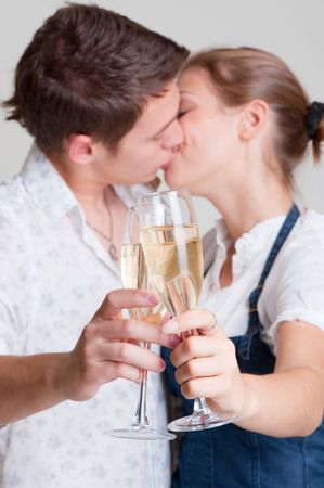 beautiful kissing couple with glasses photo