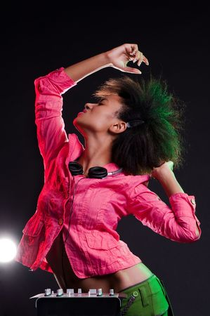 alluring: alluring deejay dancing against black background Stock Photo