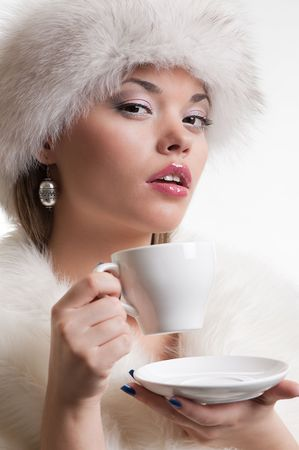 portrait of alluring woman with cup of coffee photo