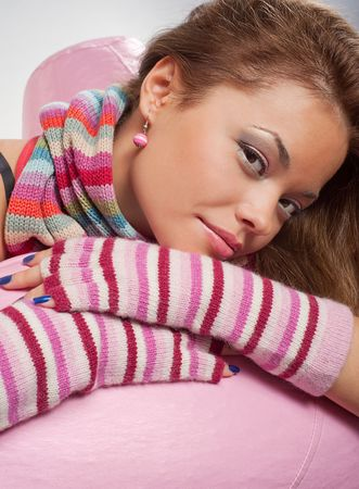 portrait of pretty woman in striped scarf and gloves photo