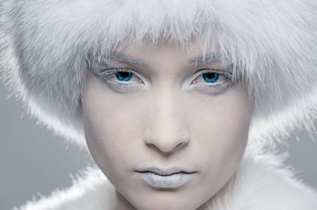 closeup portrait of frozen model in white fur photo