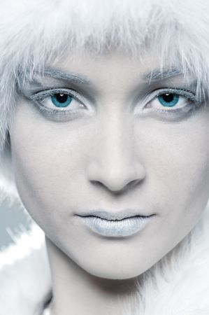 portrait of snowy woman with blue eyes