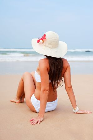 attractive woman resting and looking at the ocean photo