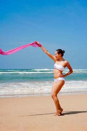 happy tanned woman in bikini on vacation photo