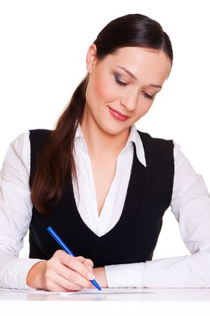 lively businesswoman writing some papers at the workplace photo