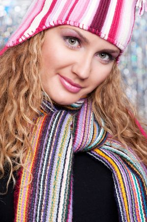 pretty young woman in striped scarf and hat photo