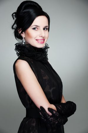 portrait of smiley graceful woman in black dress photo