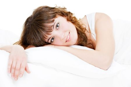 luxuriate: portrait of pretty young woman in the bed