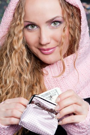 portrait of beautiful blonde with purse and money photo