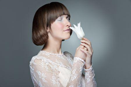 portrait of beautiful stylish woman with white tulip photo