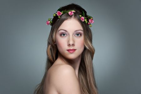 portrait of beautiful young woman with garland from small roses on her hair Stock Photo - 6595157