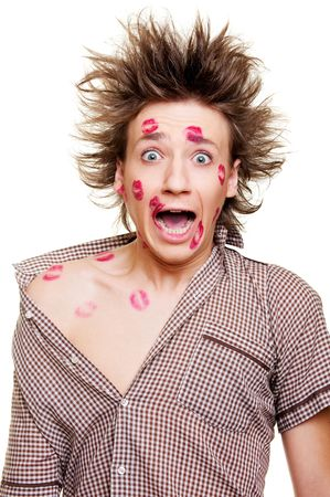 funny portrait of young man with kisses Stock Photo - 6595158