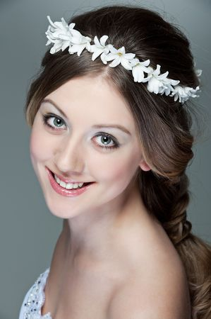 portrait of beautiful woman with white garland on her hair Stock Photo - 6595129